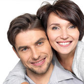 Closeup portrait of beautiful happy couple - isolated — Stock Photo