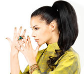 Woman with golden nails and precious stone emerald — Stock Photo