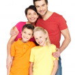 Happy family with two children on white — Stock Photo #24412481