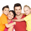 Happy family with two children on white — Stock Photo