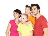 Happy family with two children looking side — Stock Photo