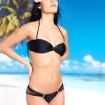 Woman in bikini at beach — Stock Photo #24716643