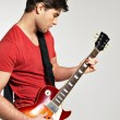 Guitarist plays on the electric guitar — Stock Photo