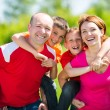Happy family with two children on nature — Stock Photo