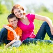 Stock Photo: Happy mother and son outdoor portrait