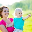 Happy mother and son at field — Stock Photo