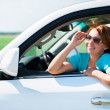 Happy woman in white new car at nature — Stock Photo #32078215