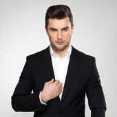 Fashion young businessman in black suit — Stock Photo
