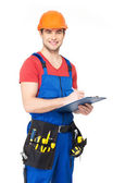 Worker with tools, planning and writing the note — Stock Photo