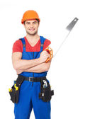 Handyman with saw — Stockfoto