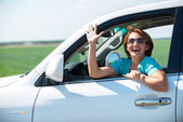 Happy woman in white new car at nature — Foto Stock
