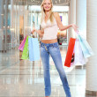 Stock Photo: Woman with shopping bags at shop