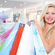 Woman with shopping bags at shop — Stockfoto