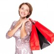 Smiling woman with shopping bags — Stock Photo
