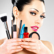 Stock Photo: Beautiful woman with makeup brushes