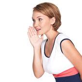 Portrait of pretty woman whispering gossip — Stock Photo