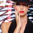 Beautiful woman with red lips and nails in black hat — Stock Photo #32812915