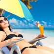 Woman on vacation enjoying at beach — Stock Photo