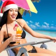 woman celebrating the new year at the beach — Stock Photo