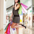 Woman with shopping bags at shop — Stock Photo #32813009