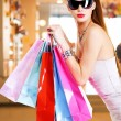 Beautiful fashion woman with shopping bags — Stock Photo #32813033