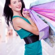 Woman with shopping bags at shop — Stock Photo