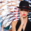 Beautiful woman with red lips and nails in black hat — Stock Photo