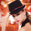 Beautiful sexy woman with red lips and black hat — Stock Photo #32813383