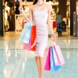 Beautiful fashion woman with shopping bags — Stock Photo #32813423