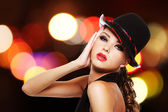 Sexy woman with bright red lips and fashionable hat — Stock Photo
