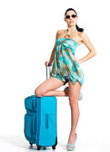 Casual woman standing with travel suitcase — Stock Photo