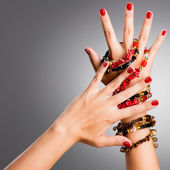 Closeup photo of a female hands with red nails — Stock Photo