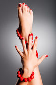 Closeup photo of a beautiful female feet with red pedicure — Stock Photo