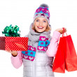 Happy woman with gifts after shopping to the new year — Stock Photo #32890749