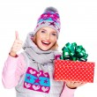 Photo of happy woman with a gift in a winter outerwear — Stock Photo