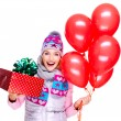 Fun happy young woman with red gift box and balloons — Stock Photo