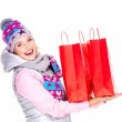 Happy woman with gifts after shopping to the new year — Stock Photo