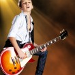 Boy playing on electric guitar on the stage — Stok fotoğraf