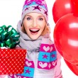 Closeup portrait of fun happy adult woman with red gift box and — Stock Photo #32890599