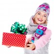 Happy smiling woman giving a christmas gift — Stock Photo