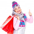 Woman with shopping bags shows thumbs up sign — Stock Photo #32890659