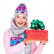 Photo of happy woman with a gift in a winter outerwear — Stock Photo #32890683