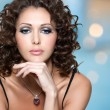Face of beautiful woman with long curly hairs — Stock Photo