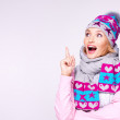 Happy surprised woman in winter clothes with positive emotions — Stock Photo