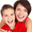 Laughing young mother with son 8 year old — Stock Photo