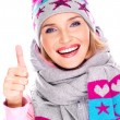 Happy adult girl in winter clothes with thumbs up — Stock Photo #32891107