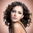 Face of beautiful adult woman with curly hairs — Stock Photo