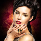 Beautiful woman with golded nails and red lips — Stock Photo