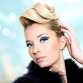 Woman with fashion hairstyle and blue eye makeup — Stock Photo