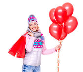 Smiling woman with gifts and red balloons after shopping — Stock Photo